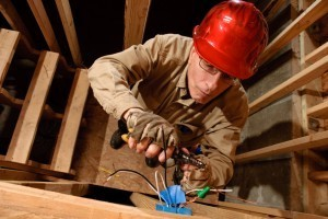 Electrician Working on Junction Box New Construction