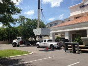 Crane lifting new Air Conditioners at Spring Hill Suites Sarasota