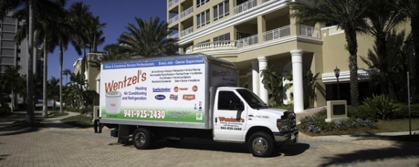 Wentzels heating and air conditioning truck in front of a Condominium in Sarasota, Florida